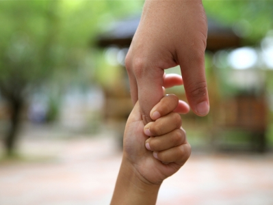 Child & Adult holding hands